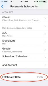 """The Passwords & Accounts screen on an iPhone with """"Fetch New Data"""" circled in red"""