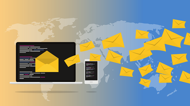 An illustration of a computer keyboard with yellow envelopes flying from the screen